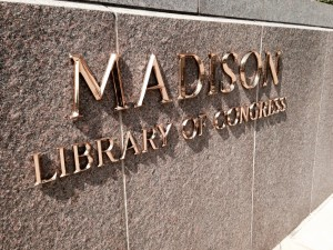 Gold-colored sign for the Madison Building of the Library of Congress