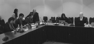 Picture of the captioned people sitting at a table in the Copyright Office